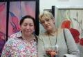 На фоне работ художника С. Барковой